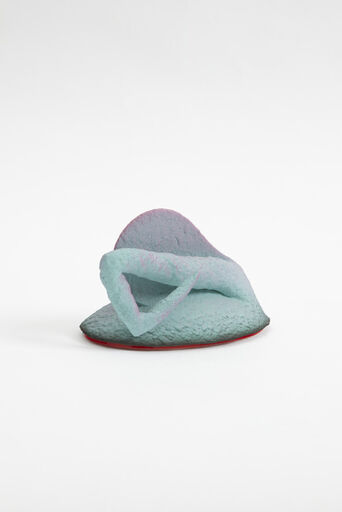 A small, abstract, cast earthenware piece, painted in a turquoise and purple gradient. The form of the piece consists of a rounded, oval, shape, with a protruding, crooked, pointed appendage.