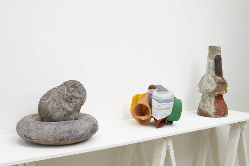 An installation view of three ceramic sculptures, including Robert Arneson's Corn, Cassie Griffin's Untitled, and Peter Voulkos' Vase.