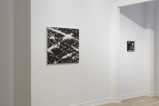 An installation view consisting of the Peter Alexander painting Menlo, and the small Peter Alexander drawing Untitled (LA Nights).