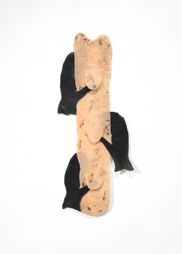 A wall piece consisting of a vertical, rectangular-shaped, textured piece of peach-colored silicone, bordered by three pieces of black silicone shaped like mittens.