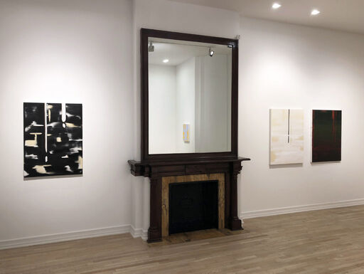 An installation view consisting of three medium-sized abstract paintings, including a black canvas with white and yellow brushstrokes, a beige canvas with white, horizontal brushstrokes, and a primarily deep green canvas with subtle red layers and drips.