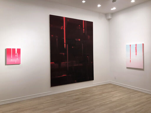 An installation view consisting of a small, bright pink abstract painting with white layers and vertical drips, a large, primarily black abstract painting revealing bright red layers and brushstrokes, and a medium-sized abstract painting with a light blue and pink gradation, and bright pink, vertical drips.
