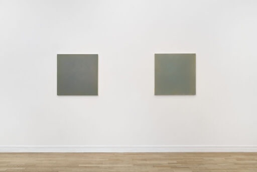 A head-on installation view of Anne Appleby's Last Light (May) and Last Light (New Moon), two primarily blue-grey monochrome square paintings.