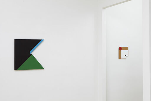 An installation view of two small Tony Delap paintings, Extra Spice and Gimac.