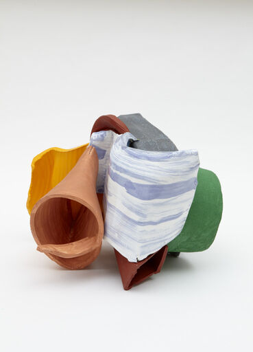 An abstract clay piece, consisting of several curved, asymmetrical, connected organic forms. The individual pieces of clay are painted in vibrant colors, including green, grey, peach, rust red, yellow and orange, and blue and white.