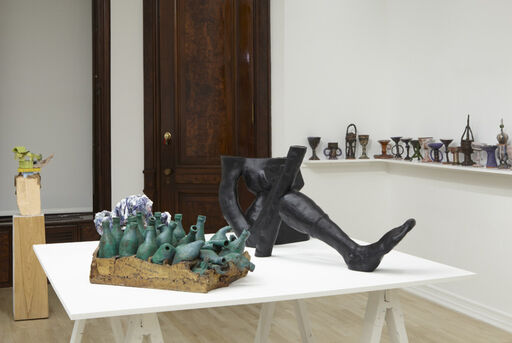 An installation view of several ceramic sculptures, including Robert Arneson's Sick Pack, Jesse Wine's Moody Wine, Arlene Shechet's Hunky-Dory, Julia Haft-Candell's Heavy Weight, and Josh Smith's The Last Crusade.