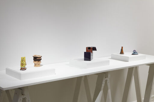 An installation view of five small ceramic sculptures, including Kathy Butterfly's Twist and Just for Men, Ken Price's Untitled (Geometric), and Ron Nagle's Untitled and Finchilada.