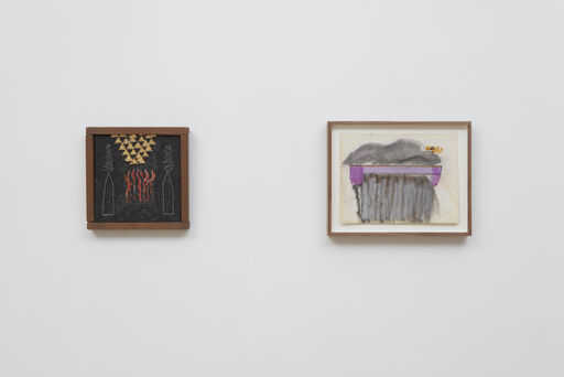 An installation view of a small, black Forrest Bess painting of red, fire-like marks bordered by two pencil-shaped outlines and a number of small, yellow triangles, and a Joan Snyder drawing of a purple horizontal strip, enclosed by grey, cloud-like marks and a small yellow detail.