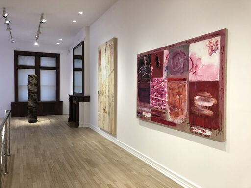 An installation view consisting of Jackie Winsor's sculpture Dark Vertical Cylinder, and Joan Snyder's paintings Mulberry and Canal and Tone Poem.